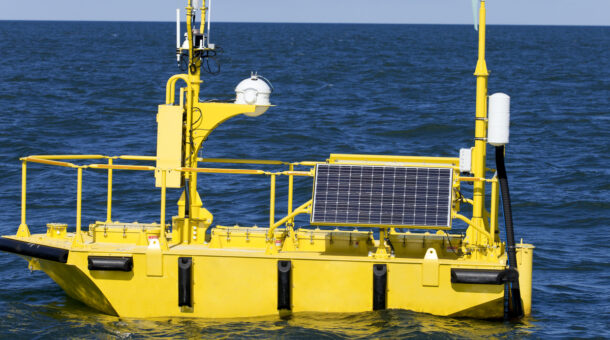 A cicture of a yellow solar powered boat